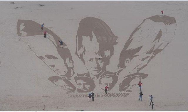 Protestë me art në rërë, mesazh liderëve të G7: