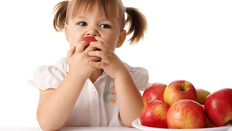kid eats an apple