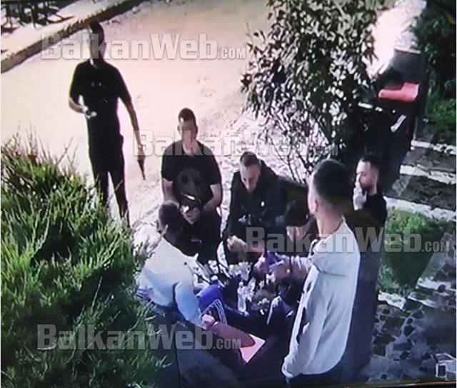 There are images from the murder in Tirana / The author with a gun in his hand,