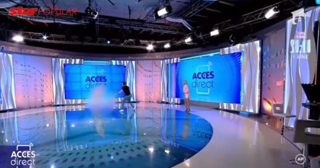 Video/ Një grua nudo hyn live në emision dhe godet me tullë