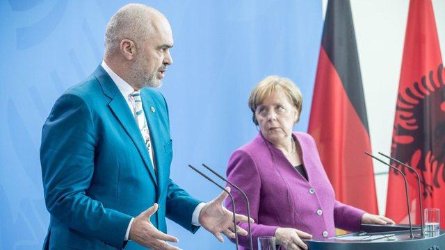 Chancellor Angela Merkel arrives in Rinas